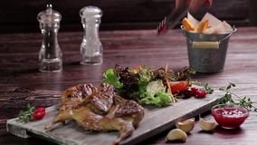 Roast quail with vegetable salad. stock video footage