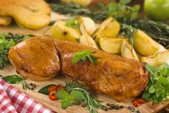 Roast rabbit. With herbs and pears Royalty Free Stock Image