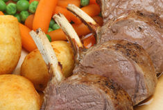 Roast Rack of Lamb. Rack of lamb with roast potatoes, vegetables and gravy Stock Image