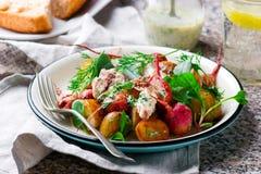 Roast radish new potato peppered mackerel salad. Style vintage .selective focus royalty free stock images