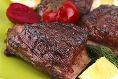 Roast rib's on dish Stock Images