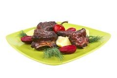 Roast rib's on green dish Royalty Free Stock Image