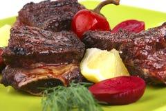 Roast rib's on green dish Stock Images
