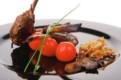 Roast ribs on plate Royalty Free Stock Photo