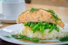 Roast salmon, beans and potatoes Stock Images