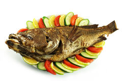 Roast sea bass and vegetables Stock Photos