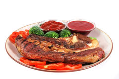Roast served beef steak and chili sauces Stock Image