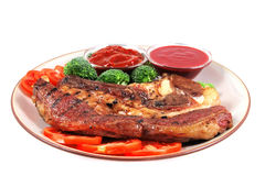 Roast served beef steak and chili sauces Stock Images