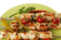 Roast shish kebab with vegetables Stock Image