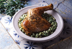 Roast shoulder of lamb and broad beans Royalty Free Stock Photo