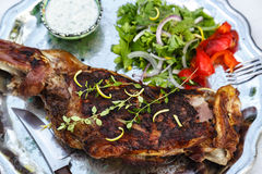 Roast shoulder of lamb with herbs Stock Photo
