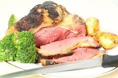 Roast sirloin beef joint with knife Stock Images