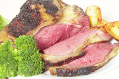 Roast sirloin beef joint on plate Royalty Free Stock Photography