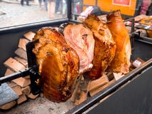 Roast smoked pork at Prague. Roasted smoked pork legs ham grilling in street food market at Prague, Czech Republic Royalty Free Stock Images