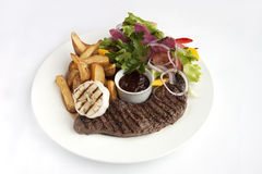Roast steak with garnish Stock Photo