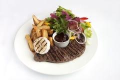 Roast steak with garnish Stock Photo