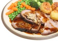 Roast Stuffed Loin of Pork Dinner stock photos
