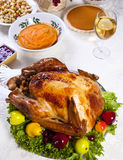 Roast stuffed turkey. Thanksgiving dinner with roast turkey, , pumpkin pie, gravy,  cranberry chutney stuffing etc Royalty Free Stock Photography
