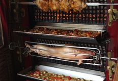 Roast suckling pig on a rotisserie in Paris, France Stock Image