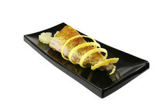 Roast tuna with lemon on ceramic Stock Images