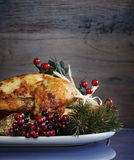 Roast turkey against dark rustic wood background. Vertical with copyspace Royalty Free Stock Images