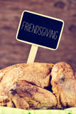 Roast turkey with a black label with the text friendsgiving Stock Images