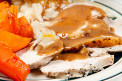 Roast turkey dinner. Roast turkey breast with mashed potatoes, sweet potatoes, carrots and lots of gravy Stock Images