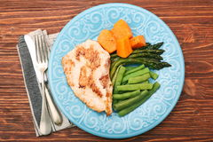 Roast turkey fillet with asparagus pumpkin and green beans Royalty Free Stock Photos