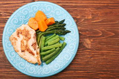 Roast turkey fillet with asparagus pumpkin and green beans Stock Photo