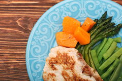 Roast turkey fillet with asparagus pumpkin and green beans Stock Photos