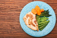 Roast turkey fillet with asparagus pumpkin and green beans Royalty Free Stock Images