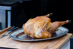 Roast turkey. Kitchen wooden utensils on vintage style stock images