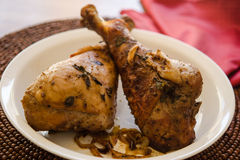Roast turkey legs on plate with place mat Stock Image