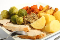 Roast turkey meal. A meal of roast turkey with all the trimmings - brussels sprouts, roast sweet potatoes, roast parsnips stuffing and boiled potatoes stock photo