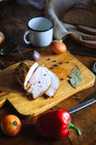 Roast turkey meat with bay leaf, pepper and garlic on old cutting board, Vintage country table. Delicious roast turkey meat with bay leaf, pepper and garlic on stock image