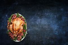 Roast Turkey over Chalkboard Texture Background royalty free stock photo