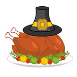 Roast turkey for Thanksgiving and pilgrim hat. fowl on plate. fr Royalty Free Stock Photos