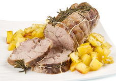 Roast of veal with potatoes stock images