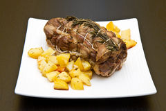 Roast of veal with potatoes stock image