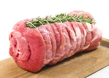 Roast of veal with rosemary. In white background royalty free stock photo