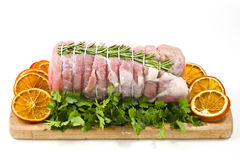 Roast veal with rosemary and orange slices Royalty Free Stock Photo