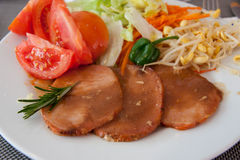 Roast of veal with sauce and salad. A roast of veal with a fresh season salad Stock Photo