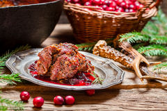Roast venison with cranberry sauce with rosemary Stock Photography