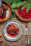 Roast venison with cranberry sauce and served in the forester lo Royalty Free Stock Photo