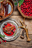 Roast venison straight from the hunt with cranberry sauce Royalty Free Stock Images
