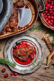 Roast venison straight from the hunt with cranberry sauce Stock Photos