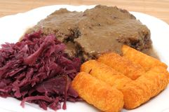 Roast of wild boar. With red cabbage and potato croquettes Stock Photography