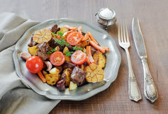 Roast wild game with vegetables Stock Images