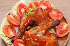 Roast wing chicken with sauce. Close up of roast wing chicken with sauce royalty free stock photo