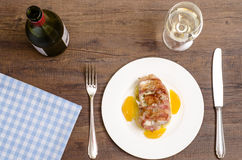 Roastad fish with bacon and white wine Royalty Free Stock Image